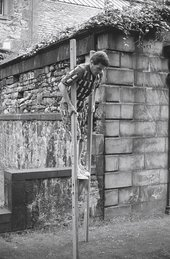 Paul Neagu performing Horizontal Rain in Greyfriars Kirkyard, Edinburgh, 1971, photographed by George Oliver