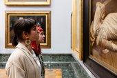 Visitors looking at art in Tate Britain