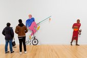 two people stood looking at an artwork by Lubaina Himid