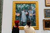 Image of people looking at art in Tate Britain