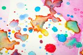 splatters of multicoloured paint on a white background