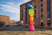 photograph of Tate Liverpool building showing Ugo Rondinone's Liverpool Mountain, a sculpture of neon boulders