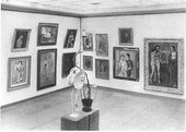 A black and white photograph of an exhibition of Picasso works