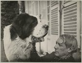 A large dog faces Picasso on a chair