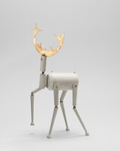 A puppet made of wood in the form of a deer
