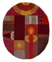 An oval rug with red and orange coloured shapes