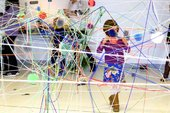Kid in a string installation
