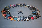 Members of the public form a circle around artist Tania Bruguera during the opening of Hyundai Commission: Tania Bruguera: 10,148,451 at Tate Modern, 2018