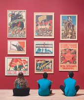 Pupils from Thomas Tallis School, south east London sit in front of revolutionary posters at the Red Star Over Russia exhibition at Tate Modern, November 2017