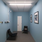 The Quiet room on level 4. A room with blue walls and two chairs.
