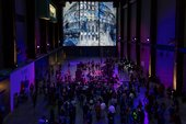 A group of people dancing in the Turbine Hall