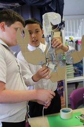 Children taking part in a creative activity.