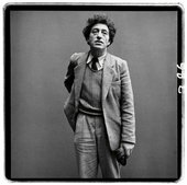 A black and white photograph of Alberto Giacometti wearing at suit, taken by Richard Avedon