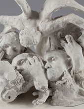 Auguste Rodin Assemblage of reduced heads of Jean d'Aire and Jean de Fiennes and hands, topped by a winged figure