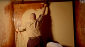 Still of actor painting a canvas in the style of Rothko
