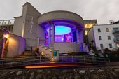 Tate St Ives bathed in coloured light