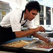 A photograph of chef Santiago Lastra preparing food
