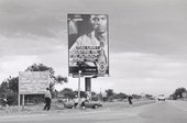 Santu Mofokeng, A Roadside Sign in Tshwane, Marabastad / Hammanskraal, c.2008, printed 2011, from the series Billboards, 1991–2009, gelatin silver print on paper, 30 x 45 cm