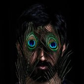 Musician Sarathy Korwar with peacock feathers over his eyes