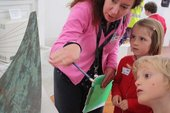 Teacher and pupils looking at Barbara Hepworth Stringed Figure (Curlew), Version II 1956 at Tate St Ives