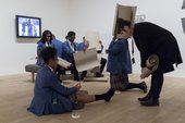 Photograph of a schools workshop at Tate Modern. Young students making cardboard sculptures in the gallery