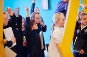 Students look at an artwork