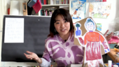 presenter joey yu holding up her cut out drawing