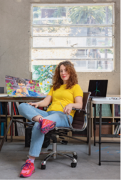 Aliza Nisenbaum sitting in her studio