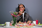 photo of a person covered in cake