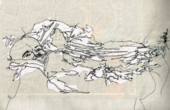 embroidery of a person sinking into a mountain range