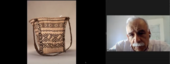 Video conference call screenshot with a single speaker on the right and an image of a woven black and white bag on the left