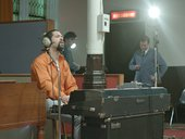a man sings in a recording studio