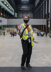 A member of Tate security staff inside the Gallery.