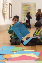 Children cutting coloured paper