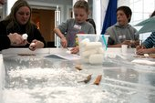 Young people carving soap