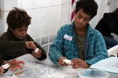 Kids carving soap to make sculptures