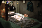 Film still of a bed with some sunlight on it