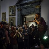MC Novelist performing in historical gallery at Tate Britain