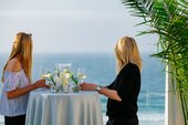 Women eating at a table enjoying the view