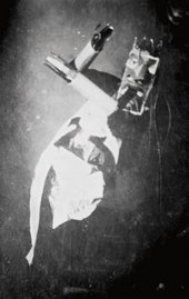 Sophie Taeuber-Arp performing to the sound poem by Hugo Ball in costume and mask probably by Jean (Hans) Arp on the occasion of the opening of the Galerie Dada, Zurich, March 1917  Stiftung Arp e.V., Berlin