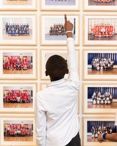 A child who participated in Year 3 spots his class portrait at Tate Britain