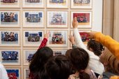 primary school children point at a school photograph in the Duveens gallery