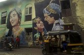 Colour photograph of a graffiti art showing bollywood actors on the side of an Indian building