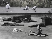 two black and white photos put together of people on a concrete floor with newspapers and bags on the floor