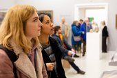 two people look at art in the St Ives Modern Art display