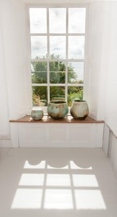 Photograph of ceramics pots by a window