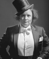 Susan Calman photographed in black and white wearing a top hat