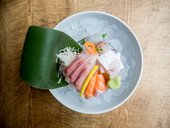 Colourful sashimi in a bowl