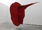 blood red sculpture suspended in gallery space