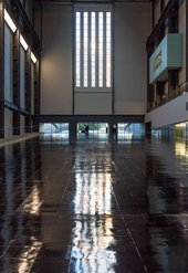Photograph of the empty Turbine Hall at Tate Modern with its temporary glossy black floor during Tania Bruguera's Hyundai Commission